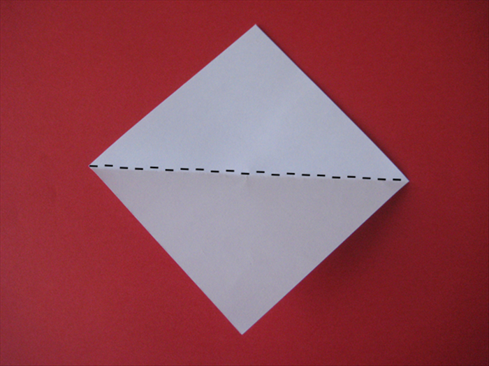 Place paper with the colored side facing down and the points at the top, bottom and sides.