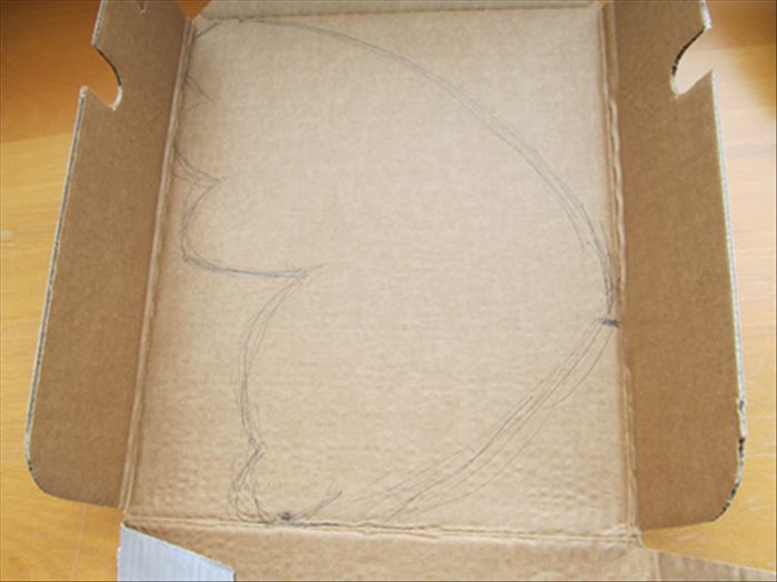 Open up the soda carton  Draw a wing shape on one of the large sides of the carton Cut out the wing shape