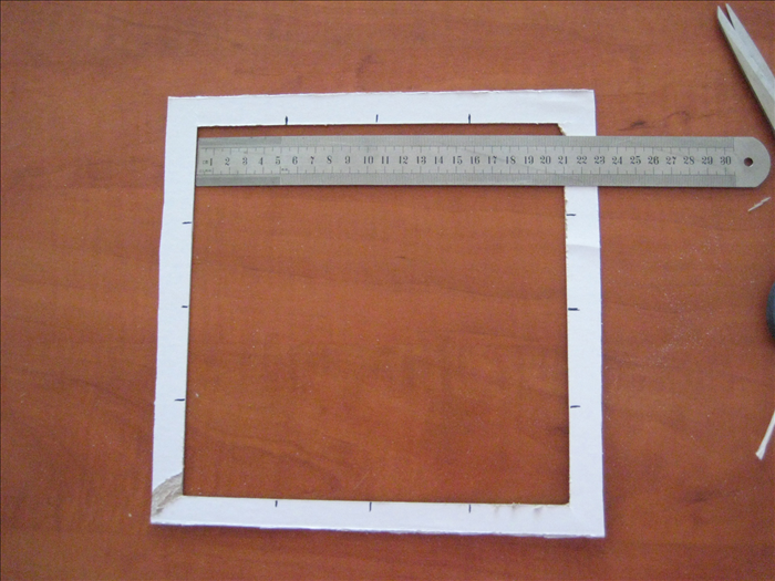 Use your ruler to find and mark the middle of each of the 4 sides.