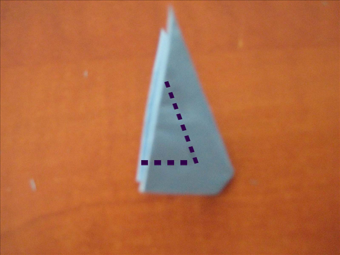 Using the midpoint of the 2 right bottom edges,  carefully cut out a small triangle.   * Pay attention that the widths remaining on right and bottom are equal