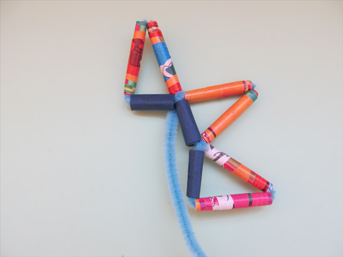 Twist the pipe cleaner around the end of the triangle next to it.