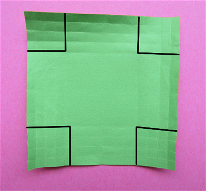Cut out a 4 by 4 squares at each corner