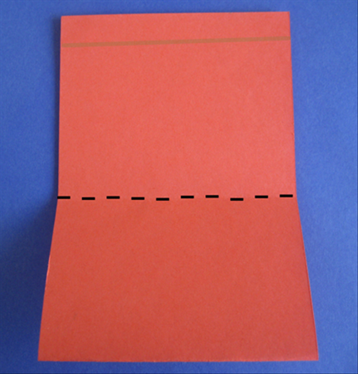 Place the paper with the open end at the top Fold the bottom edge up to ¼ inch below the top