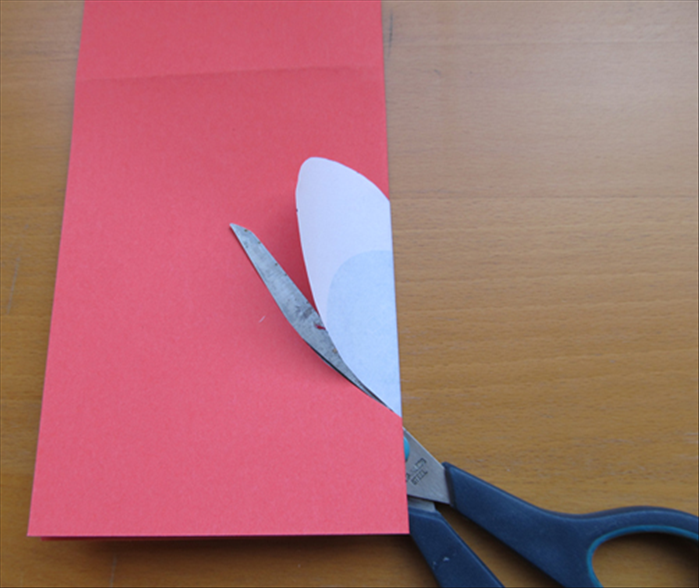 Use the heart as a guide to cut out a heart.  Leave a connecting area. See the next picture showing a yellow line where not to cut before you begin cutting