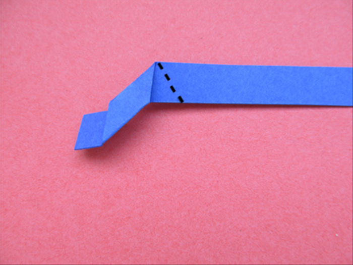Fold the strip down at an angle so that the top edge aligns with the vertical edge
