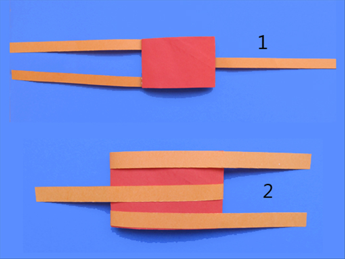 1.Take one of the rolls from step 8 and place it on the table with the strips side on the bottom.