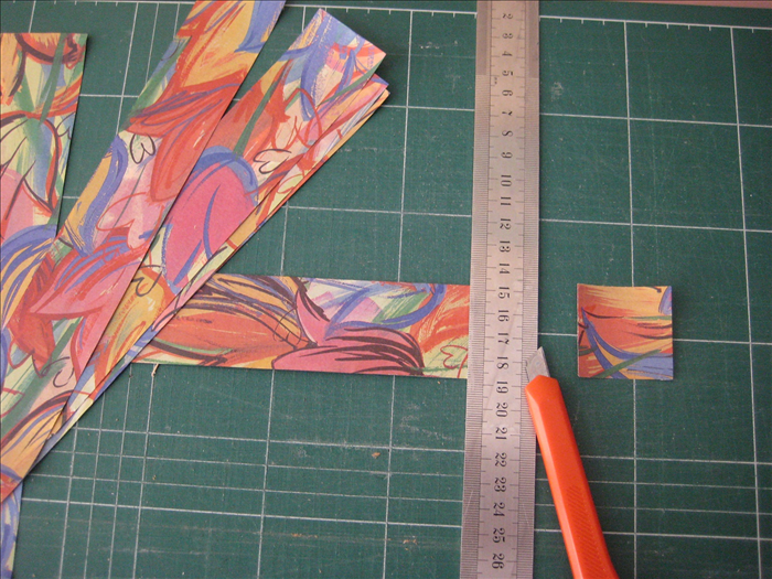 Cut your scrap paper into  32 squares  measuring 1 ½ inches X 1 ½ inches
