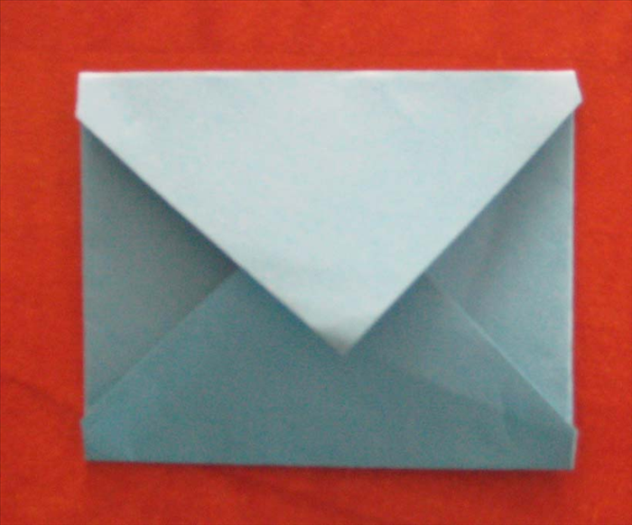 Your folded envelope is ready.  Put your letter or card inside and glue the  point of the flap  in place.