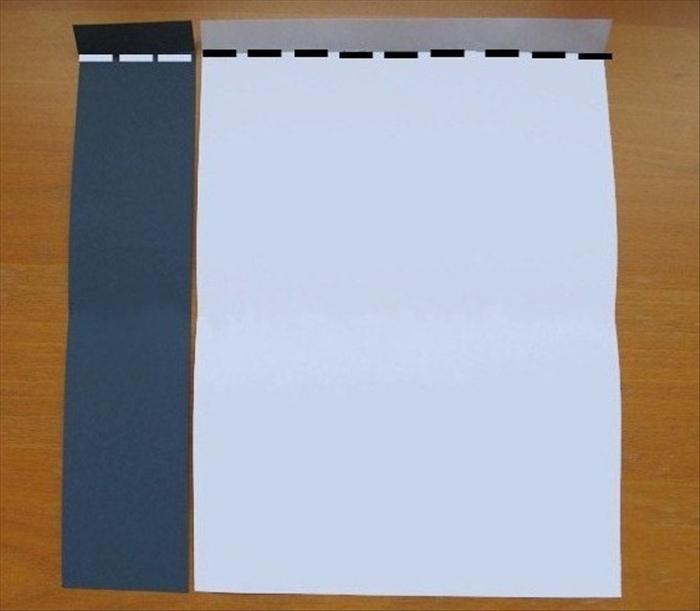 <p> Place both papers with the short edges at the top and bottom.</p>  <p> Make a 1 inch fold at the top of both papers. Unfold</p>