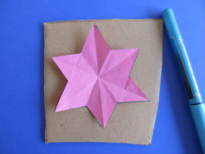<p> Unfold your star and trace the outline on a piece of cardboard.</p>  <p> Cut out the star</p>