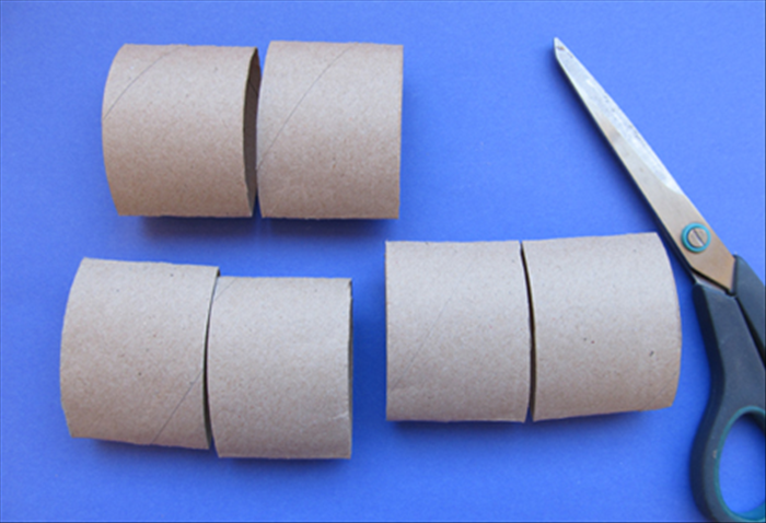 Squash the 3 rolls flat and cut them in half