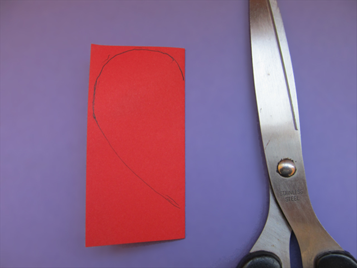 Cut a half heart shape from the folded edge
