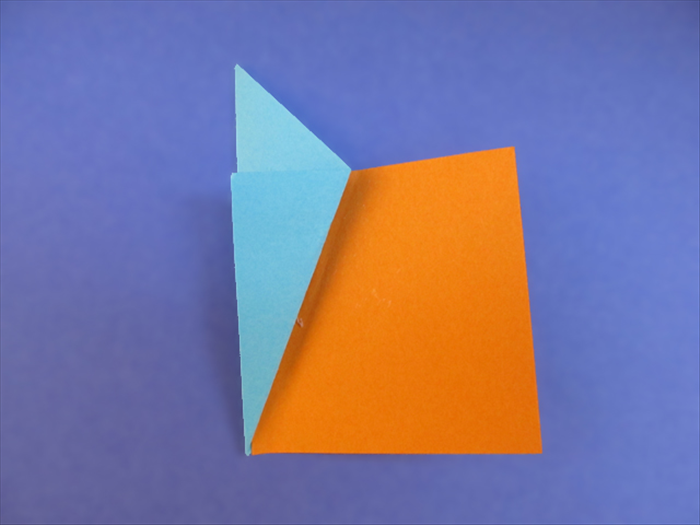 <p> Insert one of the 16 squares under the flap.</p>  <p> Slide it in until it is aligned with the inner fold.</p>  <p> Make sure the bottom edge of the square is aligned with the bottom point of the fold.</p>  <p> Lift the right side of the square and fold it over the edge of the flap.</p>  <p>  </p>