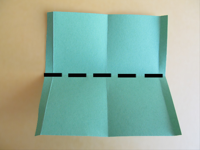 <p> Place it on the table with folded edges on the sides.</p>  <p> Bring down the top edge to fold it in half and use this crease line to cut the paper in half.</p>