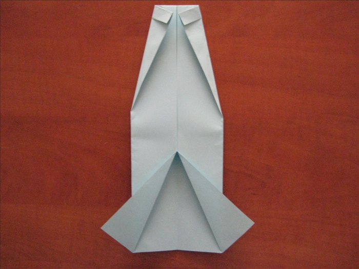 Flip the paper over again.  Fold the 2 top corners diagonally so that they meet in the center.