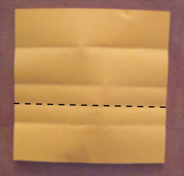 Fold the bottom edge up to the ¼ crease you just made. Unfold
