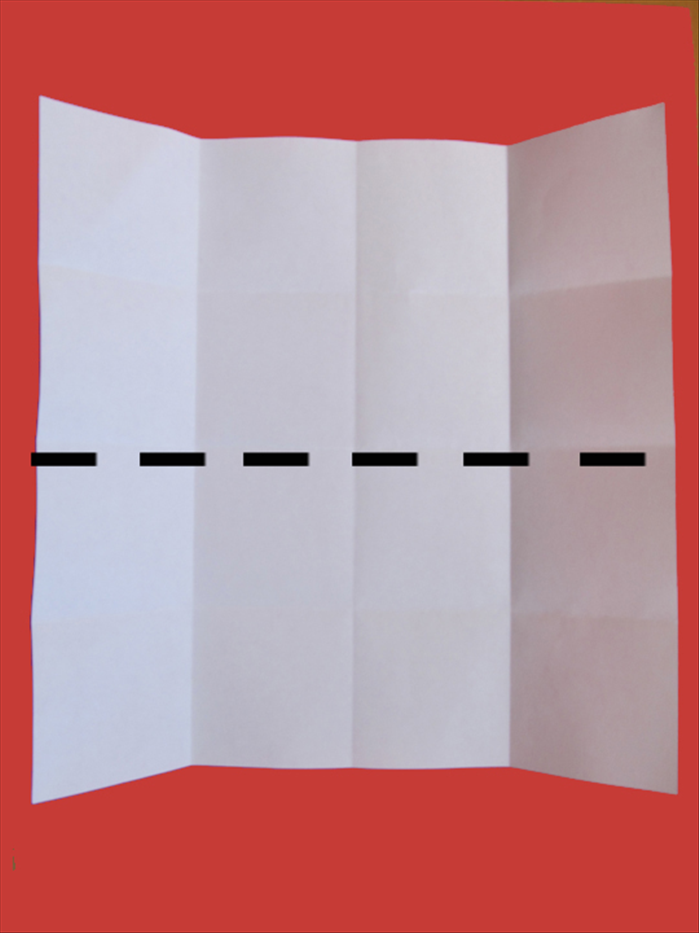 Bring the bottom edge up to the top edge  to fold the paper in half