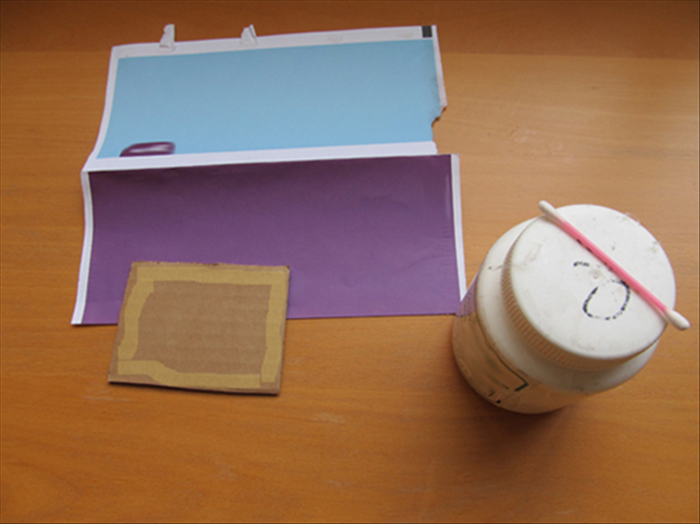 <p> Cut a piece of thick cardboard the size you want your name plaque to be. For this guide a 3 &frac12; inches by 4 inches piece was used. Apply glue only around the edges of the cardboard . and glue a peice of pretty colored junk mail or magazine page to it.</p>