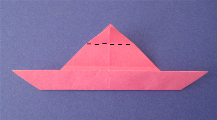 Fold the top point down to the top edge of the flap you just made
