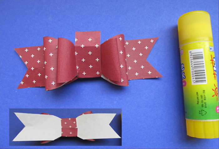 Place the small strip in the center and fold the ends over to the back. Glue the ends at the back.