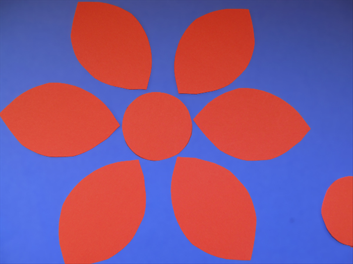 <p> Take the 6 petals and distribute them around one of the cut out circles.</p>   <p> &nbsp;</p>