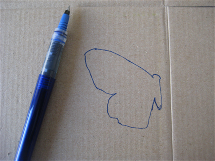 Draw the body and 1 wing on a piece of cardboard.