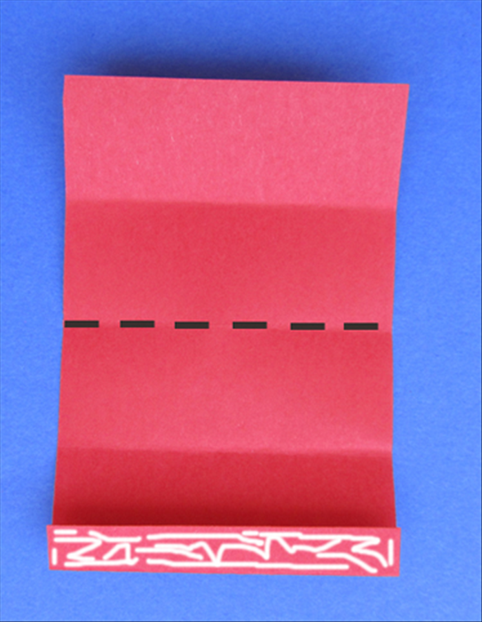 Put glue on the flap and fold the paper in half