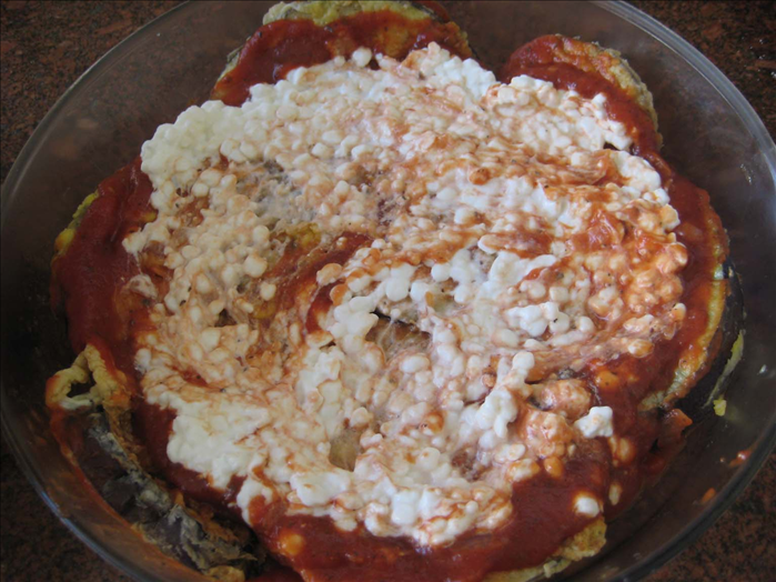 Spread some sauce on the bottom of a baking dish