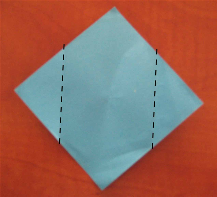 Fold  the side points to the center pinch mark you just made.