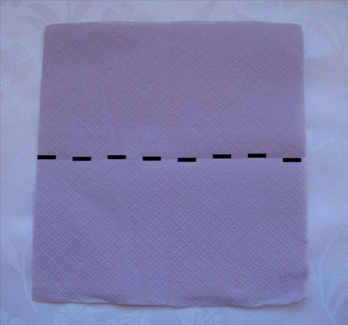 Use the napkin as it come folded in the package.
