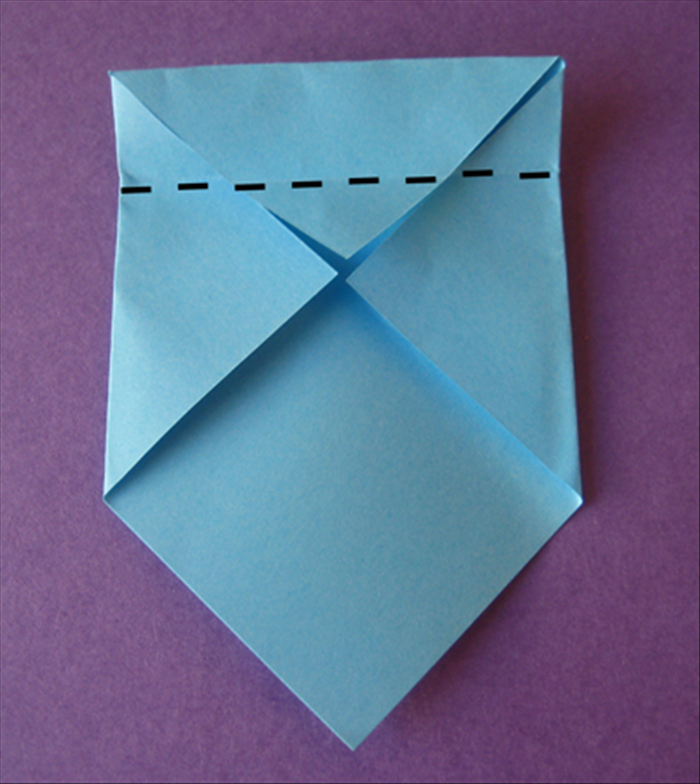 Fold the top edge down to the center and crease it.