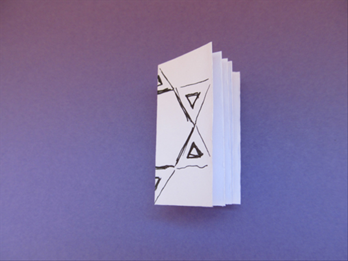 Use the fold as a guide to make to accordion fold the strip of paper