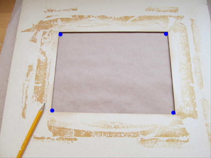 Place the paper or material face down.