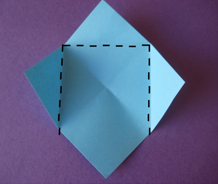 Turn the paper so that the points are at the top, bottom and sides Fold the top and side points to the center crease mark Do not fold up the bottom point