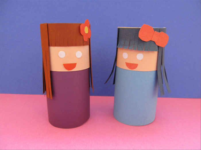 Glue on the decorations and your toilet paper doll is ready. Enjoy!