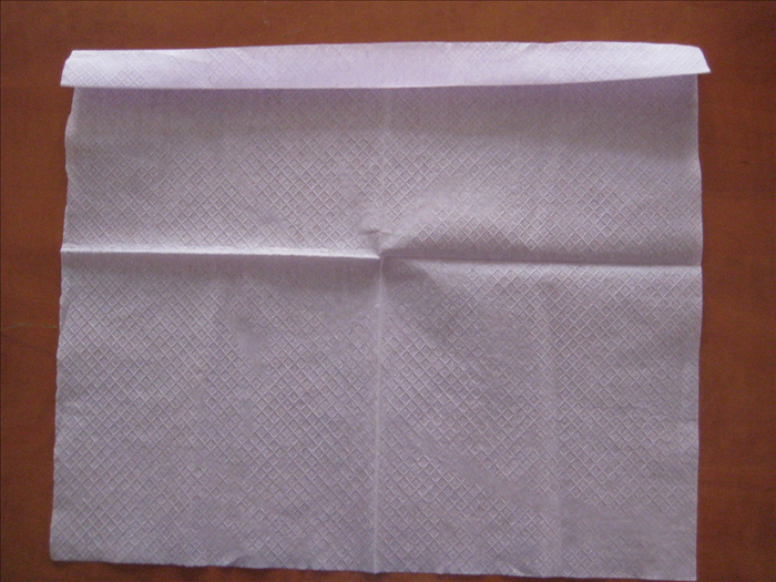 Make a small fold at one end.