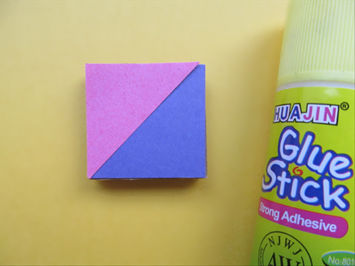 <p> Carefully align the triangle to the edges and center of the square and glue it in place.</p>   <p>  </p>