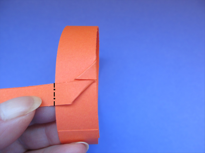 <p> Fold the strip backwards along the left edge of the band.</p>  <p>  </p>