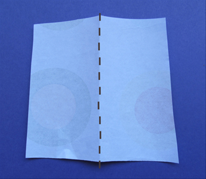 See step 6 for approximate size of the scrap paper.  Fold the scrap paper in half.