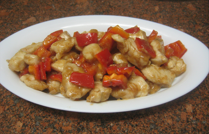 Ingredients: 2 pounds chicken cut into cubes – chicken breast or thigh meat 1 large garlic clove crushed 1 large red pepper cut into cubes 1 red hot pepper cut into small pieces - more or less depending on how hot the peppers are and how hot you like it 3 tablespoons oil  For the marinade: 1 tablespoon cornstarch 1 tablespoon soy sauce 2 tablespoons water  For cooking sauce:   1 teaspoon sugar 1 teaspoon cornstarch 1 tablespoon wine 1 tablespoon water  1 teaspoon vinegar