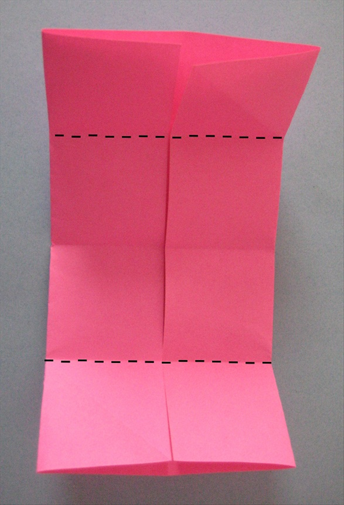 Fold the top and bottom to the center crease you just made.
