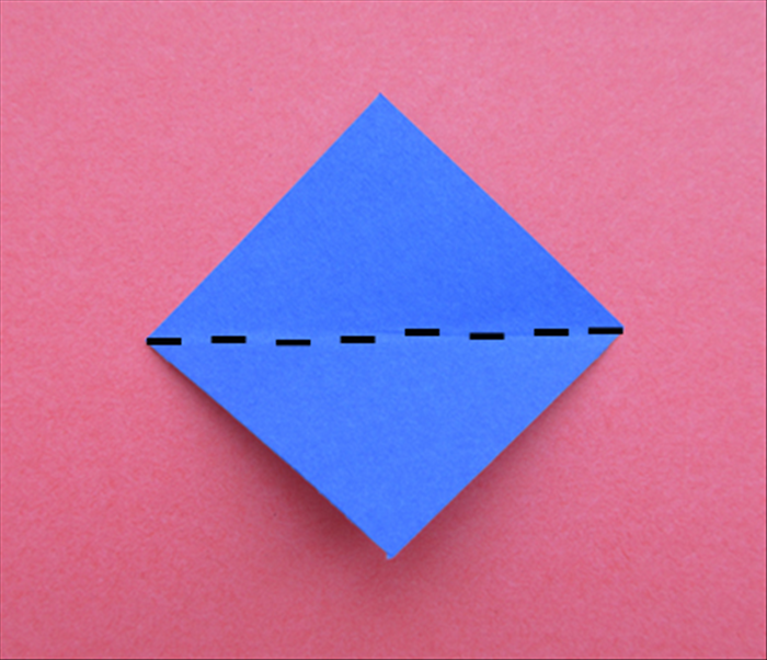 Hold the paper so that the points are at the top, bottom and sides.