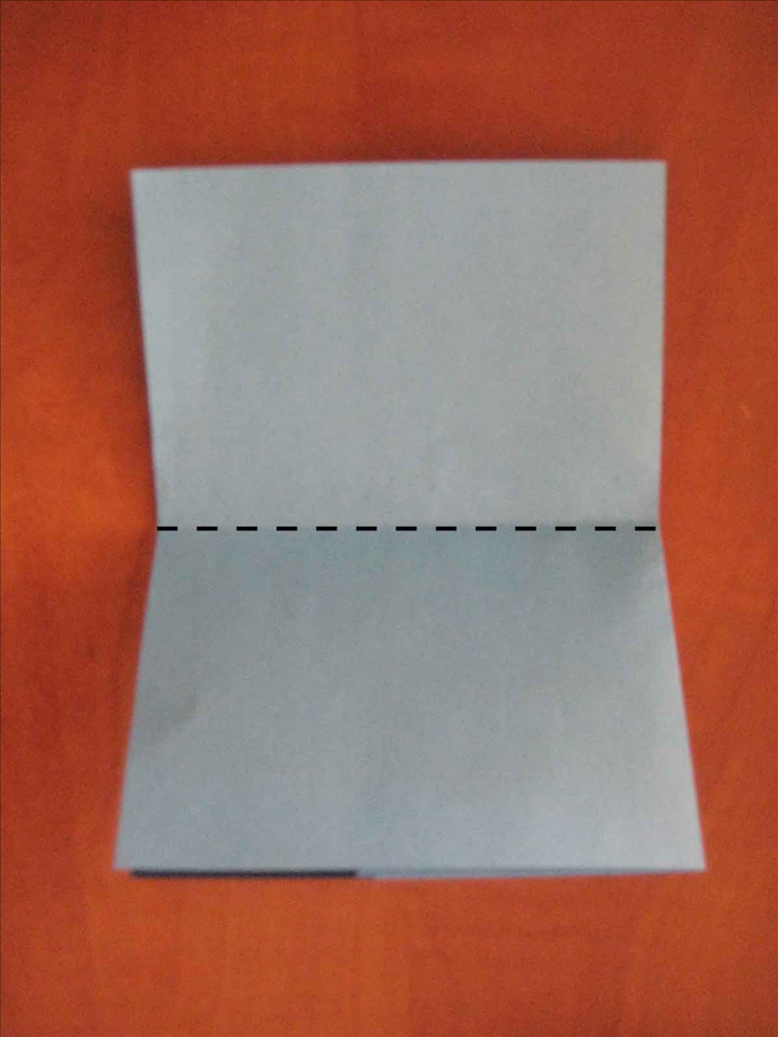 Rotate the paper so that the folded edge is on the left side  Bring the top edge down to the bottom to fold in half.