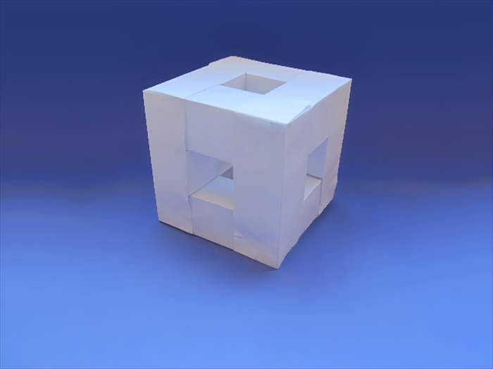<p> Align the corners and glue them in place.</p>  <p> Enjoy your 3D cube frame!</p>