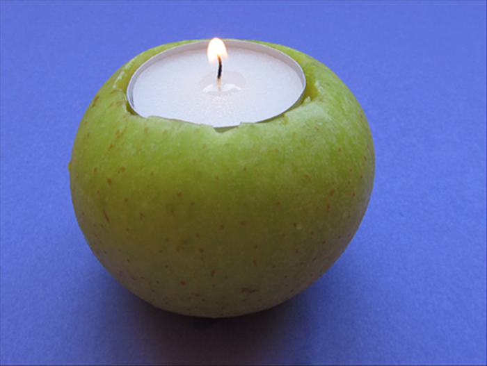 Materials:  apples candles sharp knife toothpick