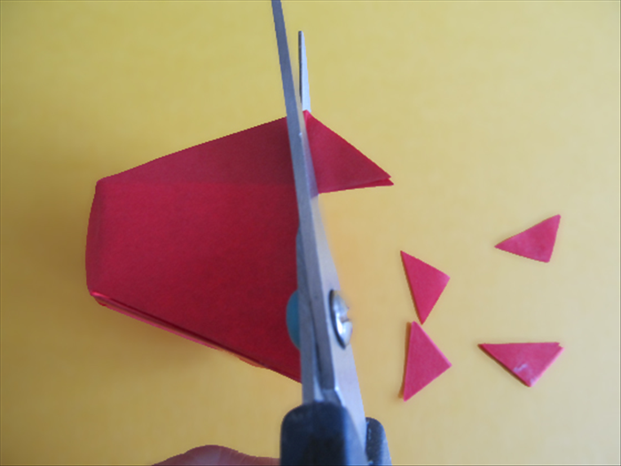<p> Use the edge as a guide to cut off the tips of triangles sticking out.</p>  <p>  </p>