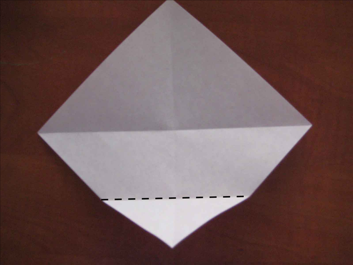 Fold the bottom point to the center.