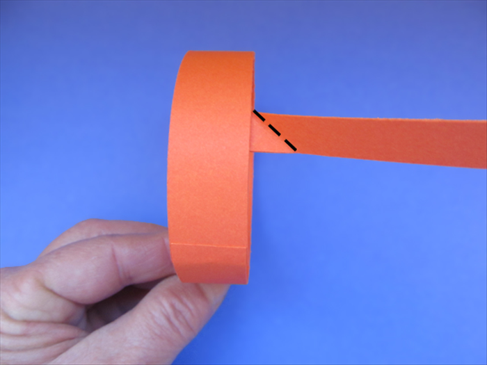 <p> Turn the band so that the thin strip is on the right side.</p>  <p> Fold the top edge of the thin strip down to align with the right side of the band.</p>  <p>  </p>