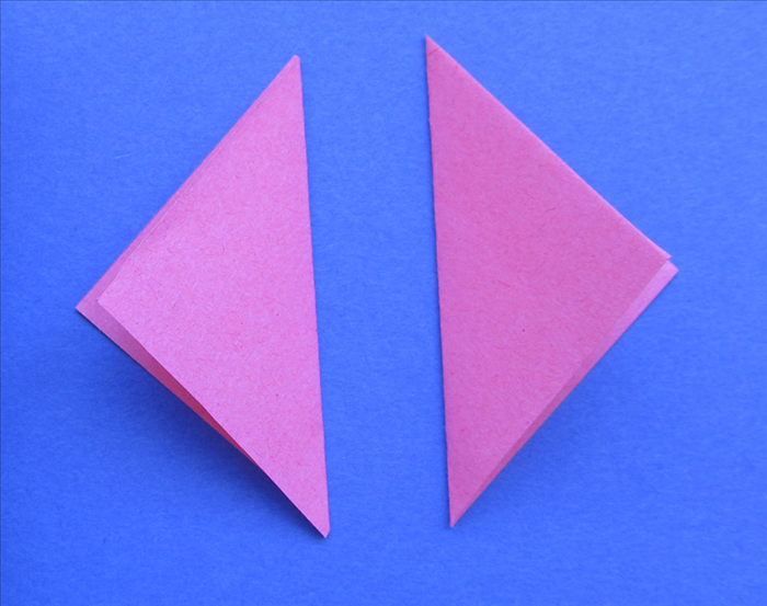 Cover one triangle with glue. Align the second triangle so that all the points align and press in place  Glue a third triangle on top