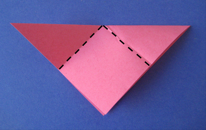 Fold the 2 corner points down to the bottom center.